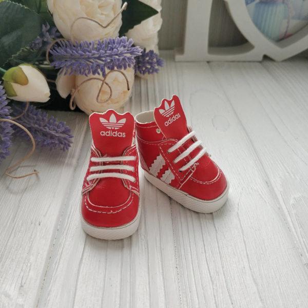 кроссовки бренд красные