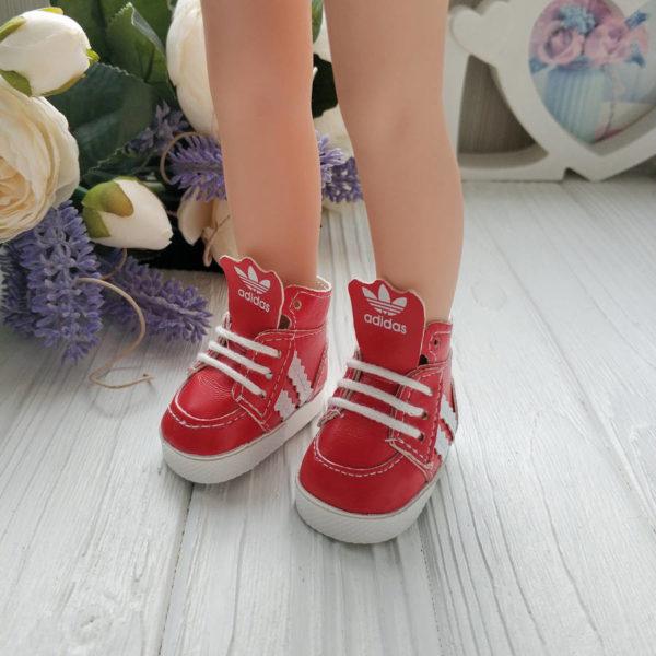 кроссовки бренд красные на ногах